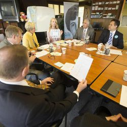 LDS leaders talk after a tour of the Avenues Children's Justice Center Tuesday, April 28, 2015, in Salt Lake City.