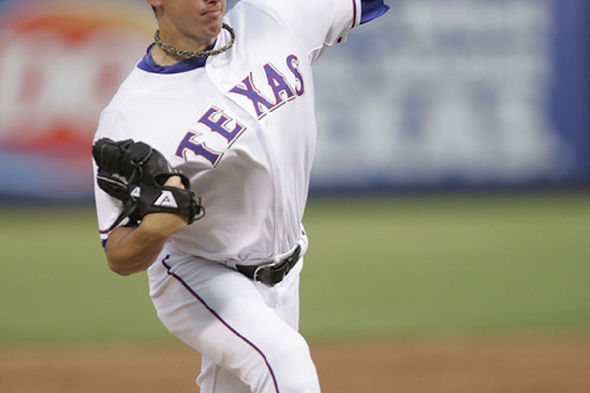 ARLINGTON, TX - JUNE 20: Derek Holland #45 of the Texas Rangers starting pitcher against the Houston Astros at Rangers Ballpark in Arlington on June 20, 2011 in Arlington, Texas.  (Photo by Rick Yeatts/Getty Images)