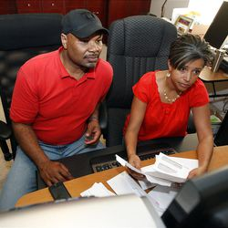 William and Paula Smith prepare their taxes at their home in Salt Lake City, Friday, March 30, 2012.