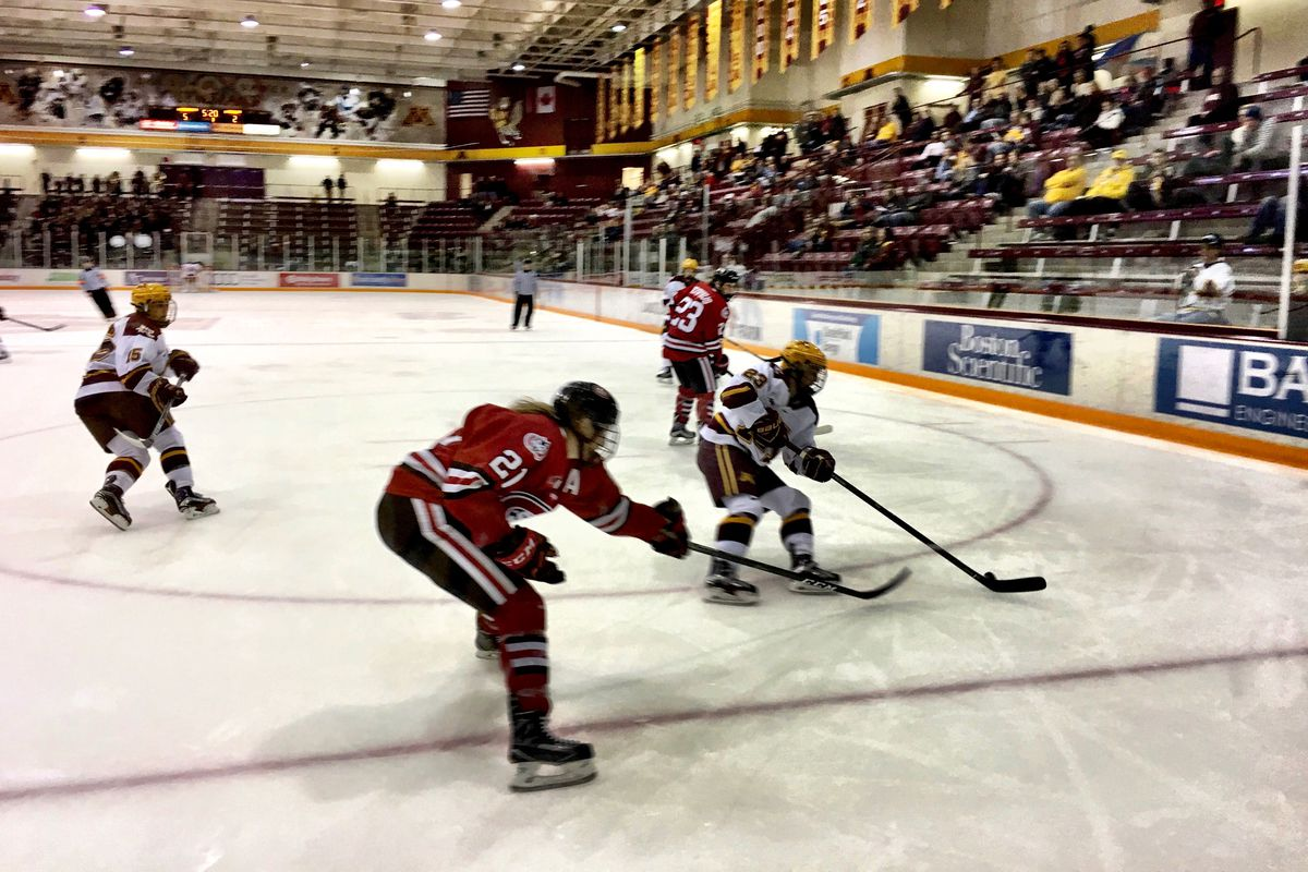 Christa Moody (St. Cloud) swipes at Caitlin Reilly's (Minnesota) stick for the puck at Ridder Arena during the  Oct 27th, 2016 game.