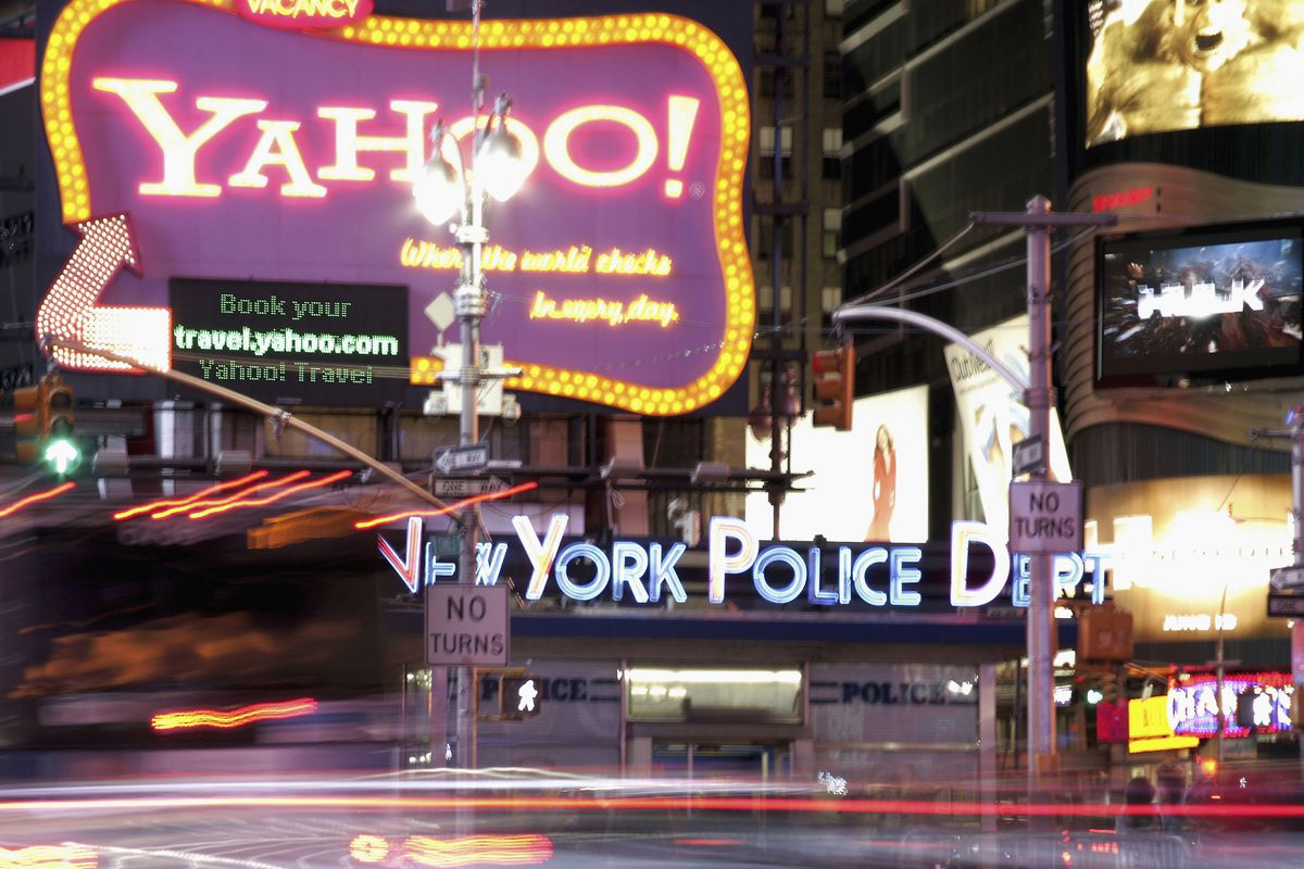 Neon signs for Yahoo and the New York Police Department at Times Square, Manhattan - New York, USA