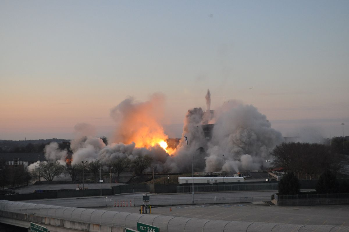 The implosion as a fireball explodes and the tower crumbles.