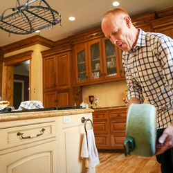 Jon Schmidt cleans up the dishes in his home in Provo on Friday, Nov. 24, 2017.