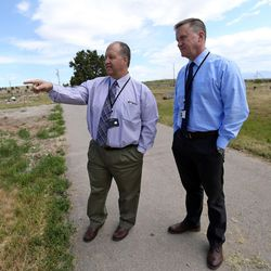 Scott Thomas, Jordan School District administrator, and Paul Bergera, Jordan School District staff assistant, visit the Bingham City Cemetery in Copperton on Thursday, May 25, 2017. The Jordan School Board has deeded the pioneer cemetery to Copperton Township after 44 years as owner and caretaker.