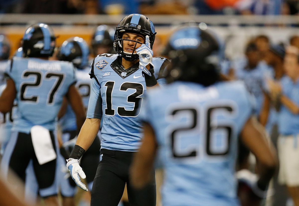DETROIT, MI - North Carolina Tar Heels wide receiver Mack Hollins (13) celebrates a blocked punt against the Rutgers Scarlet Knights during the 2014 Quick Lane Bowl at Ford Field.