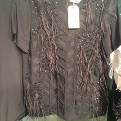 Fringed top, size 4, $250 (was $2,500)