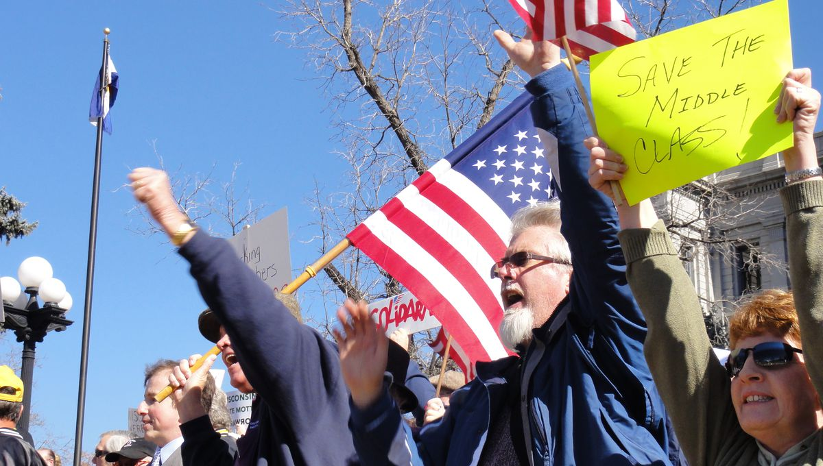 Pro-labor demonstrators shout at Tea Party counter-protesters Tuesday at the state Capitol.