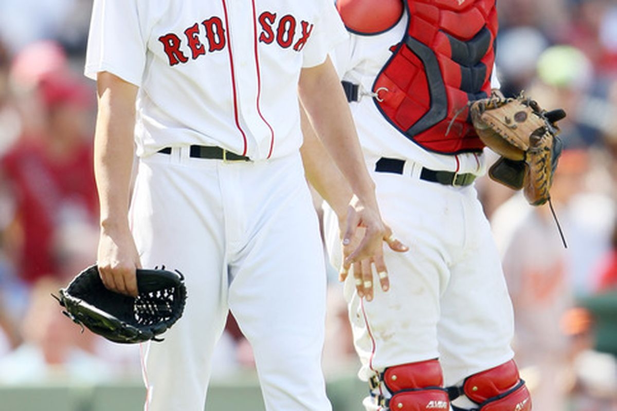 BOSTON, MA - JULY 10:  Kyle Weiland is consoled by teammate Jason Varitek after Weiland was thrown out of his major league debut game after hitting Vladimir Guerrero of the Baltimore Orioles.  (Photo by Elsa/Getty Images)