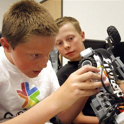 Cade Fuhriman, left, and Jesse Jordan get to work at the Graphics and Robotic Exploration with Amazing Technology camp.