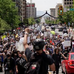 Protesters march through downtown Salt Lake City on Saturday, May 30, 2020 in the wake of the death of George Floyd, who died in police custody in Minneapolis.