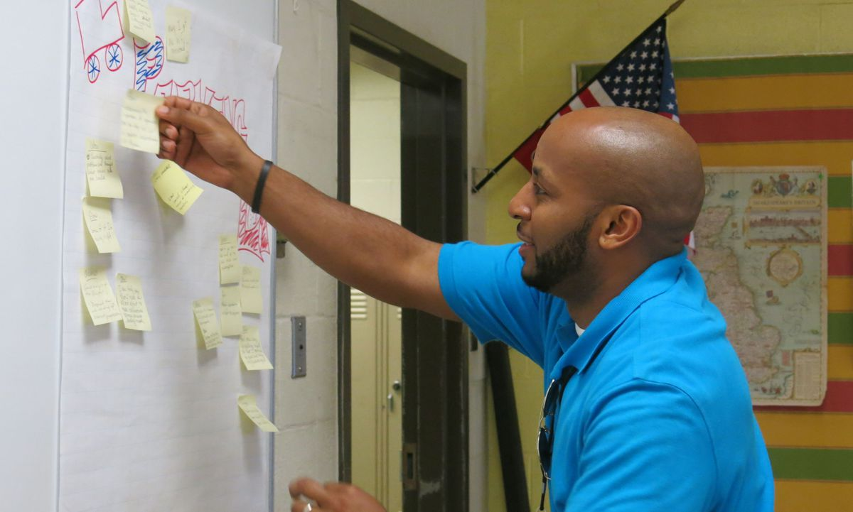 Jeffrey Mister, a Memphis instructional coach, helps train teachers on the Common Core State Standards at a Race to the Top-funded training in June 2014.