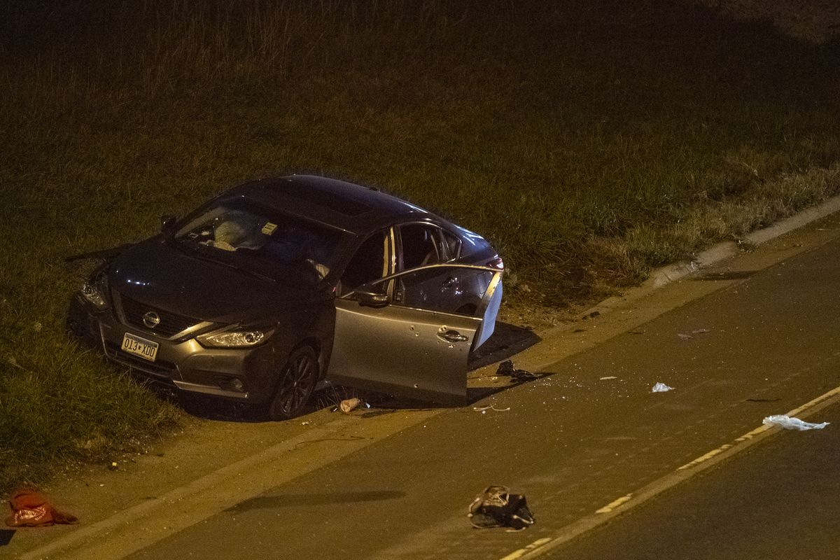 Illinois state police investigate the scene where a vehicle was shot up and crashed injuring, three people, Monday night, on I-57 near 123rd Street.   Tyler LaRiviere/Sun-Times
