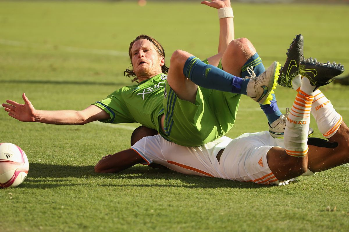 HOUSTON, TX - OCTOBER 18: Erik Friberg #28 of the Seattle Sounders FC and Ricardo Clark #13 of the Houston Dynamo battle for the ball in the first half of their game at BBVA Compass Stadium on October 18, 2015 in Houston, Texas.