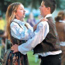 14-year-old Armanda Dzafic left and 12-year-old Muharem Durakovic dance.