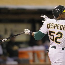 Oakland Athletics' Yoenis Cespedes hits a three-run home run off Seattle Mariners relief pitcher Steve Delabar during the seventh inning of their baseball game in Oakland, Calif., Saturday, April 7, 2012. Seattle won the game 8-7.