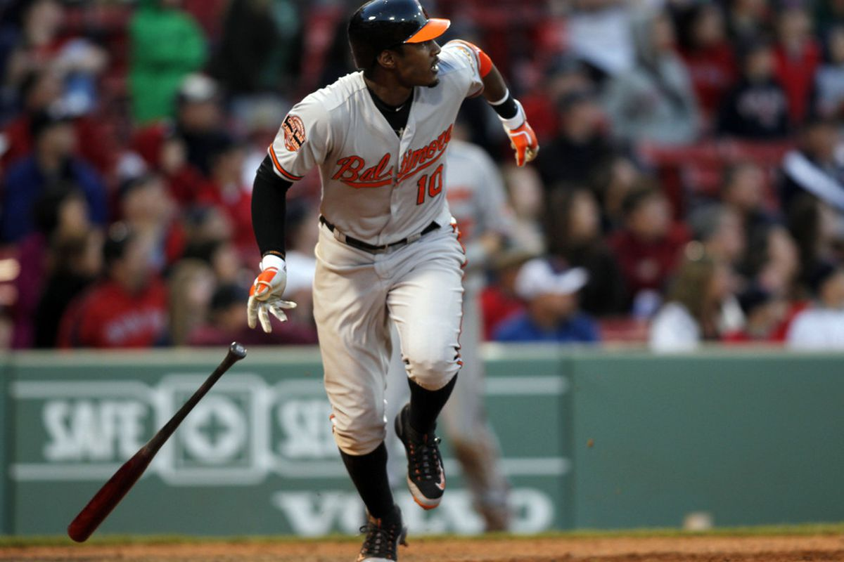 May 6, 2012; Boston, MA, USA; Baltimore Orioles center fielder Adam Jones (10) hits a three run home run off Boston Red Sox pitcher Darnell McDonald (not pictured) during the 17th inning at Fenway Park.  Mandatory Credit: Greg M. Cooper-US PRESSWIRE