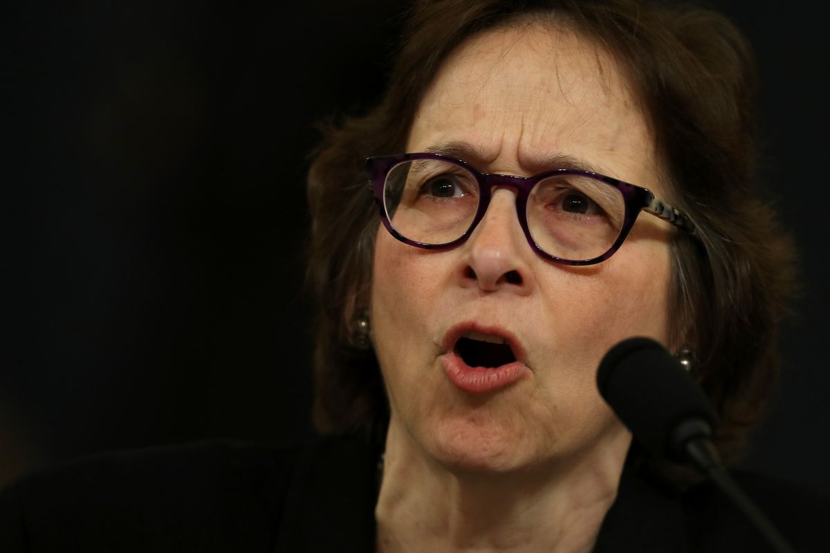 Stanford University Professor Pamela Karlan speaking into a microphone at the House Judiciary Committee hearing on impeachment.