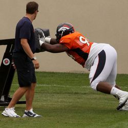 Broncos DT Terrance Knighton hits the sled during day 5 of training camp