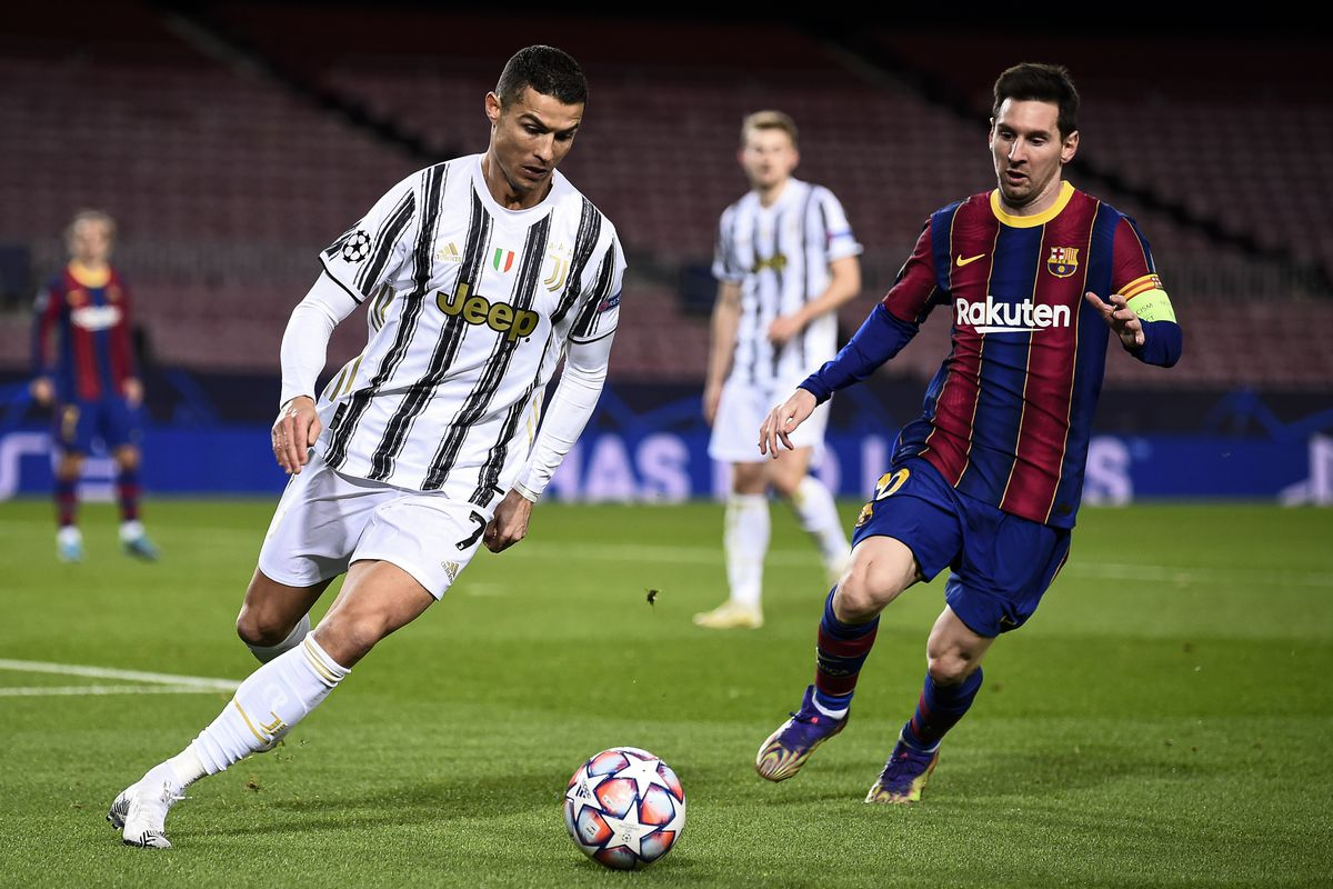Cristiano Ronaldo (L) of Juventus FC is challenged by Lionel...