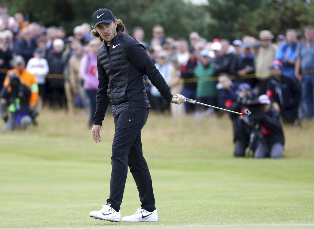 Britain's Tommy Fleetwood prepares to putt on the 1st green during the first round of the British Open Golf Championship, at Royal Birkdale, Southport, England. | Peter Morrison/Associated Press