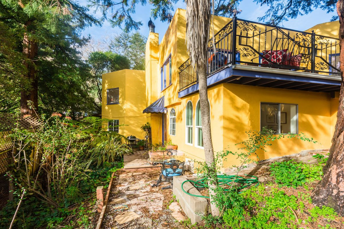 Yellow exterior of Spanish-Med home in the Berkeley Hills