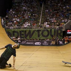 Sam Beckett of Norwich, Great Britain reacts after falling in the skateboarding vert final at Energy Solutions Arena for the Salt Lake City stop of the Dew Tour on Saturday, Sept. 10, 2011.
