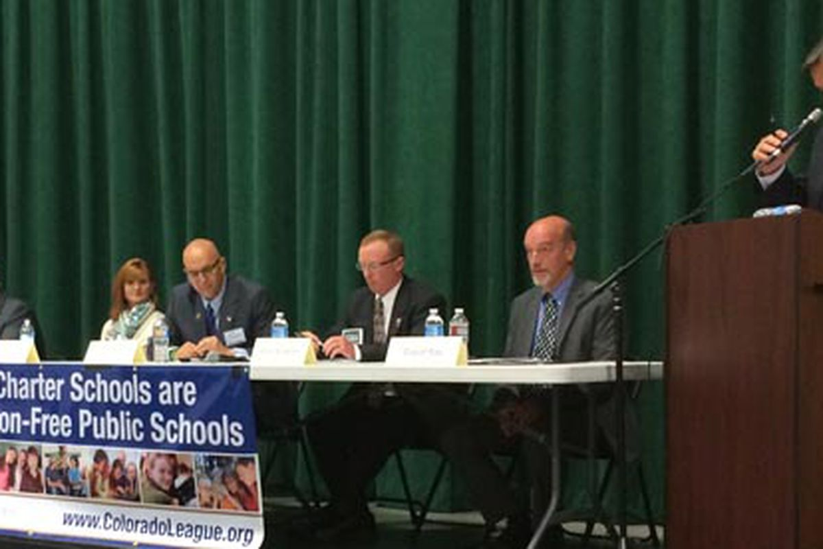 Moderator Jerry Healey (right) lays out ground rules before the Douglas County candidate forum.