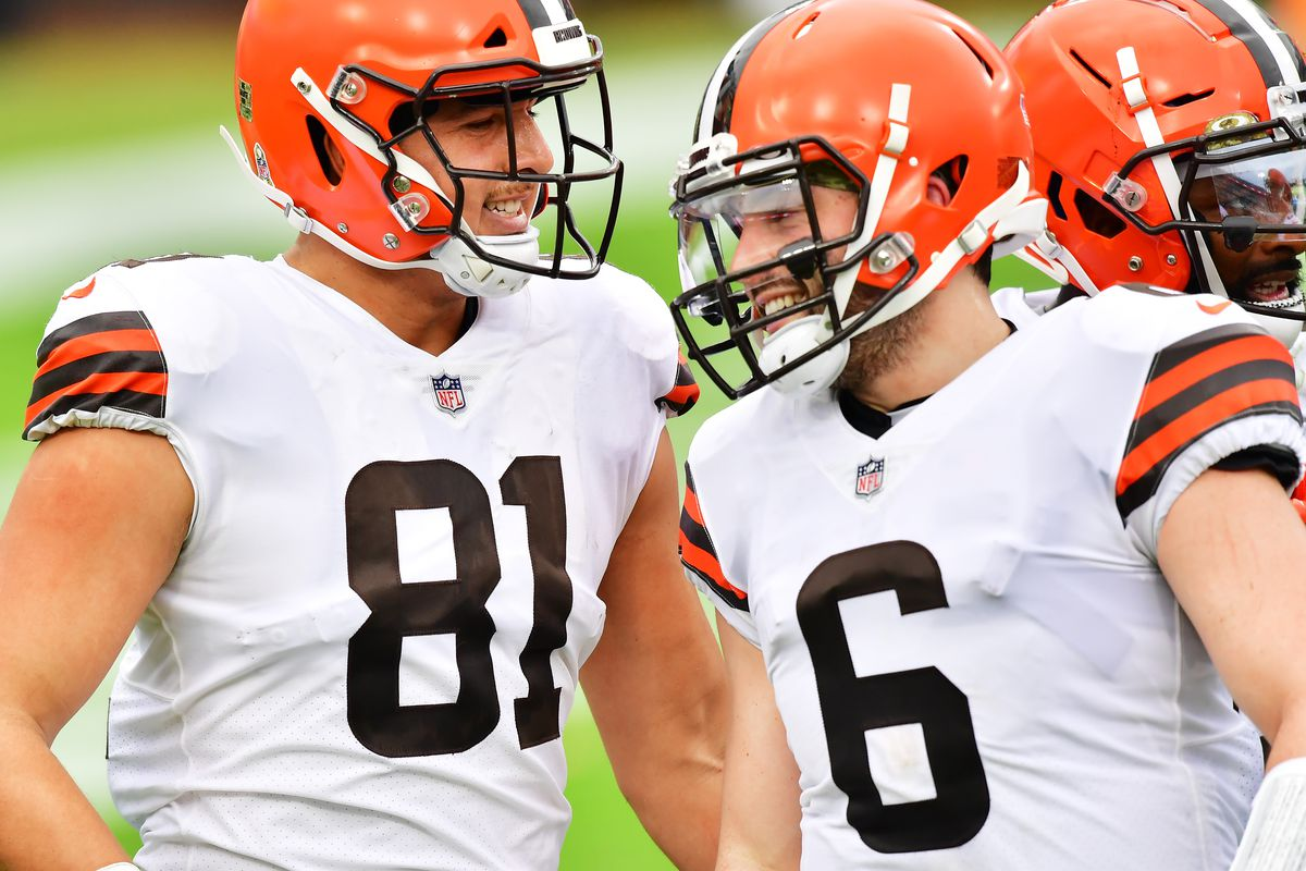Baker Mayfield #6 and Austin Hooper #81 of the Cleveland Browns celebat TIAA Bank Field on November 29, 2020 in Jacksonville, Florida.