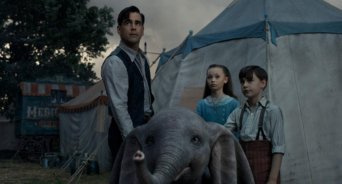 Colin Farrell, Nico Parker, and Finley Hobbs in Dumbo.