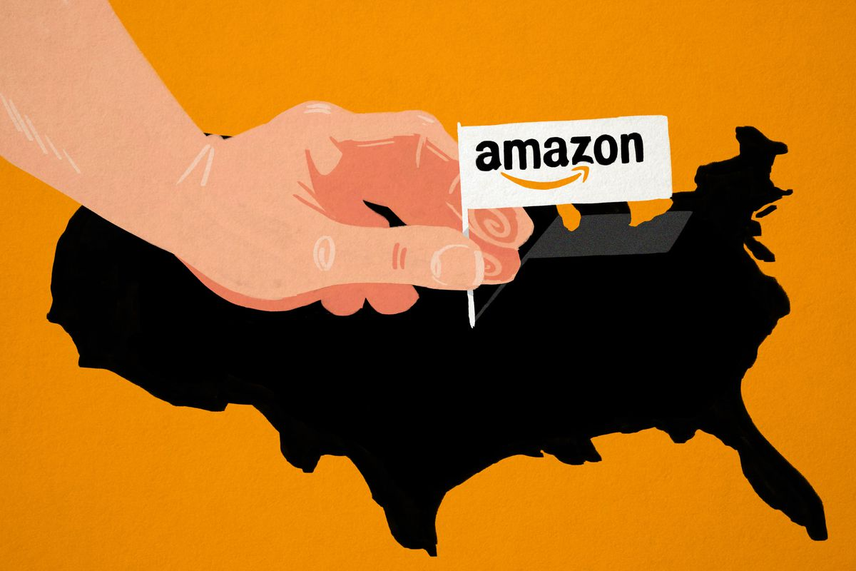 A hand placing an Amazon flag on a map of the U.S.