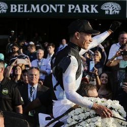 Jose Ortiz raises his hand as he rides Tapwrit to the winners circle after winning the 149th running of the Belmont Stakes horse race, Saturday, June 10, 2017, in Elmont, N.Y.
