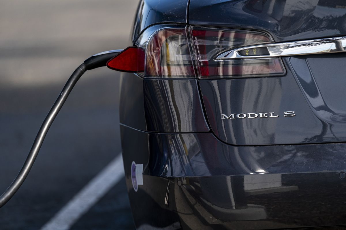 Tesla Vehicles And Charging Stations Ahead Of Earnings Figures
