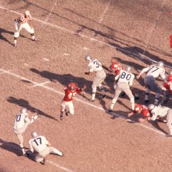 Warren Rabb #17 of the Buffalo Bills holds the ball for Billy Atkins #20 as Dave Grayson #45 of the Dallas Texans tries to block the field goal attempt during an AFL game on November 12, 1961 at the Cotton Bowl in Dallas, Texas.