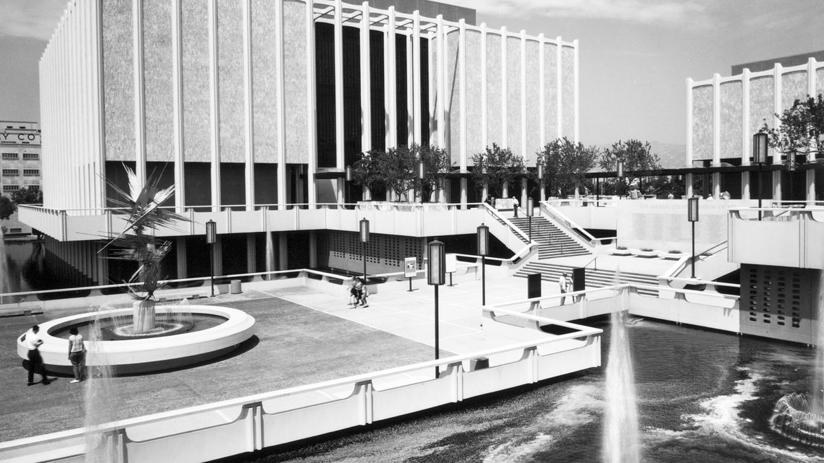A black and white image of a museum complex with buildings that appear to float over pools of water.