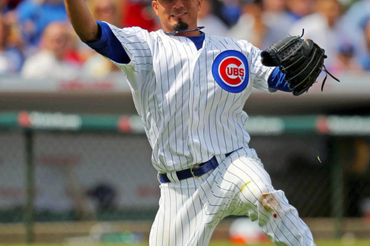Apr 7, 2012; Chicago, IL, USA; Chicago Cubs starting pitcher Matt Garza (22) throws to first base during the fifth inning against the Washington Nationals at Wrigley Field. Mandatory Credit: Dennis Wierzbicki-US PRESSWIRE