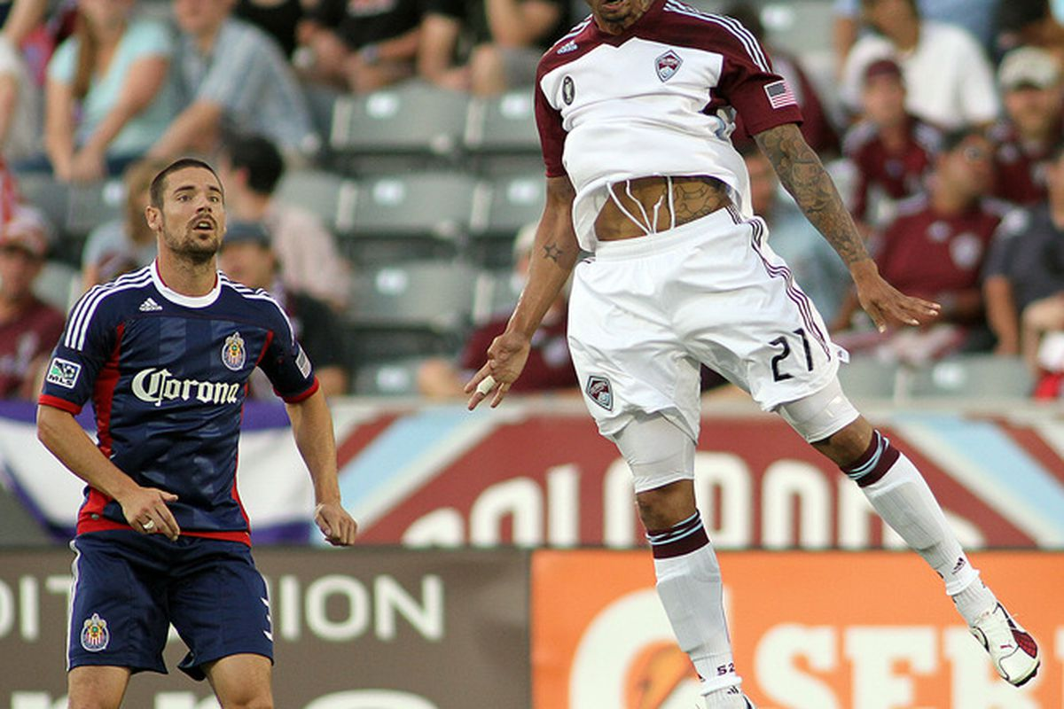 Colorado Rapids striker Caleb Folan goes airborne for a head ball in front of Heath Pearce #3 of Chivas USA during their game at Dick's Sporting Goods Park August 20, 2011 in Commerce City, Colorado. (Photo by Marc Piscotty/Getty Images)