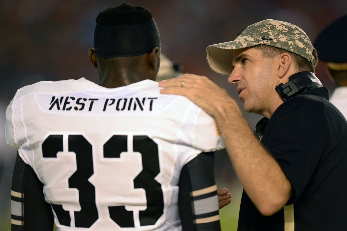Sep 8, 2012; San Diego, CA, USA; Army Black Knights wide receivers coach Andy Guyader talks to wide receiver Ejay Tucker (33) during the fourth quarter against the San Diego State Aztecs at Qualcomm Stadium. Mandatory Credit: Jake Roth-US PRESSWIRE