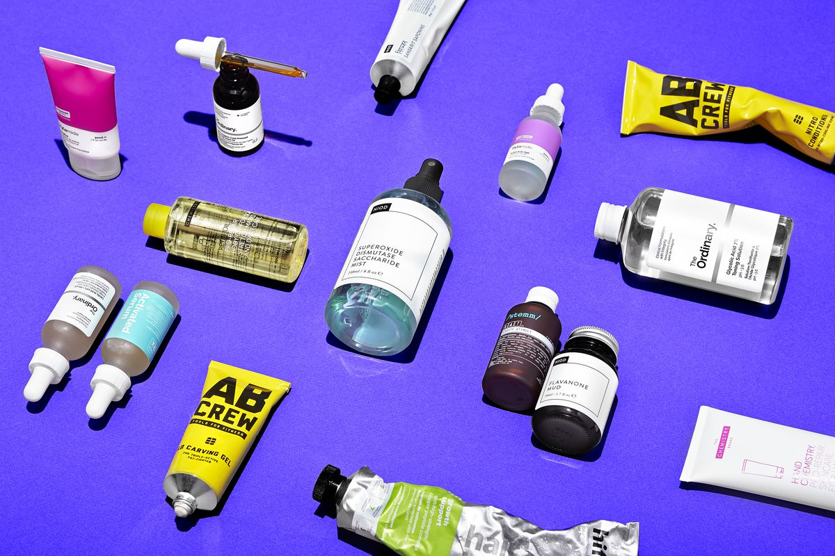 A group of Deciem products on a purple background.