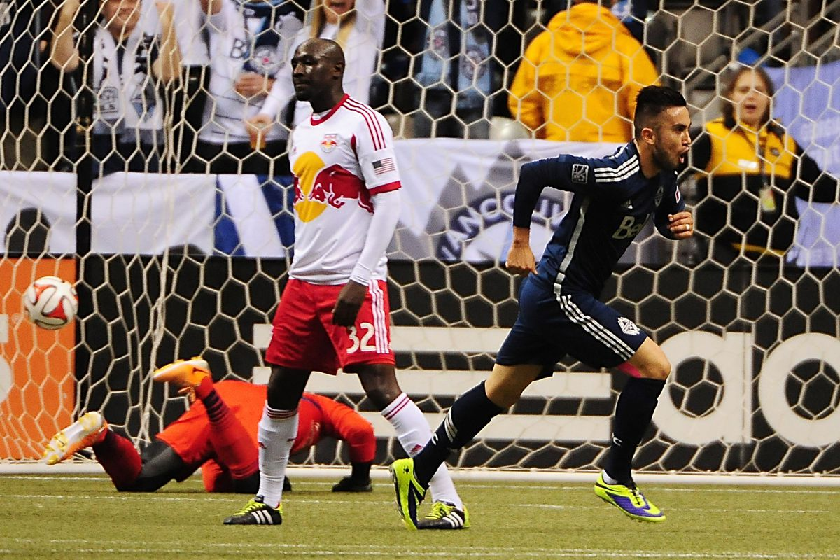 Pedro Morales (R) celebrates a goal in Vancouver's 4-1 rout of New York Red Bulls Saturday.