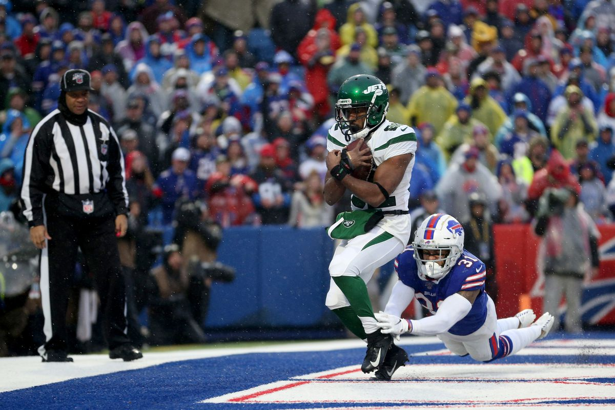 Jamison Crowder of the New York Jets scores a touchdown as Dean Marlowe of the Buffalo Bills attempts to tackle him during the fourth quarter of an NFL game at New Era Field on December 29, 2019 in Orchard Park, New York.