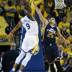 Golden State Warriors forward Andre Iguodala (9) dunks on Utah Jazz guard Raul Neto (25) in the second half of Game 2 of the NBA Western Conference Semifinals at Oracle Arena in Oakland, California, on Thursday, May 4, 2017.