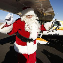 Santa waves as Santa Flight volunteers bearing Christmas gifts land in Hurricane on Wednesday, Dec. 7, 2016. Pilots with the Utah Wing of Angel Flight West filled 16 aircraft with 7,000 pounds toys, school supplies, books, backpacks and warm clothing for students at Hurricane Elementary School. The items were gathered by 16 Boy Scouts as part of their Eagle Scout service project. Since the first Santa Flight in 2000, members of the Utah Wing have worked with their local communities to gather needed supplies and toys, and deliver them to Title I schools in rural communities throughout Utah.