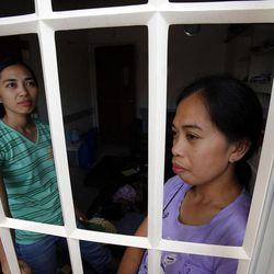 Mencho Calvo, left, and her sister Daiserie Yocte live at the chapel, Tuesday, Nov. 19, 2013, in Ormoc following a typhoon in the Philippines.