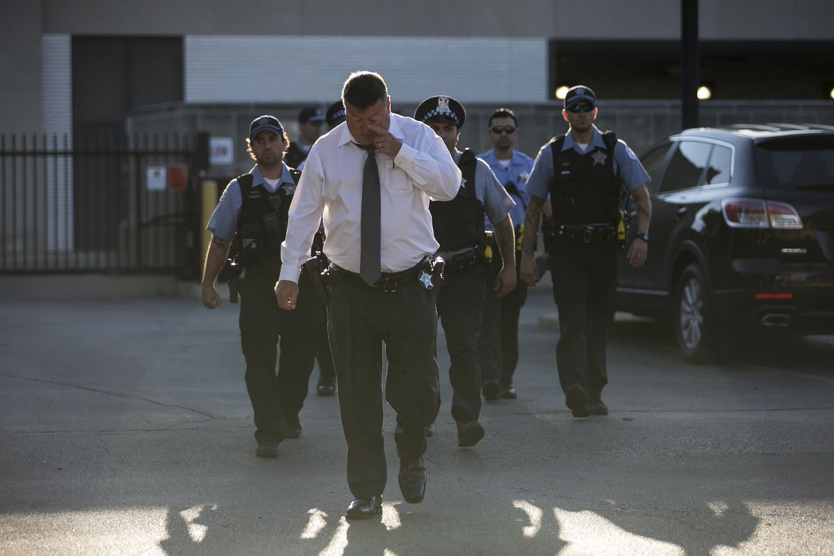 Chicago Police personnel exit the Cook County medical examiner's office after an off-duty officer was killed in a crash, Sunday, Sept. 18, 2016. | Ashlee Rezin/Sun-Times