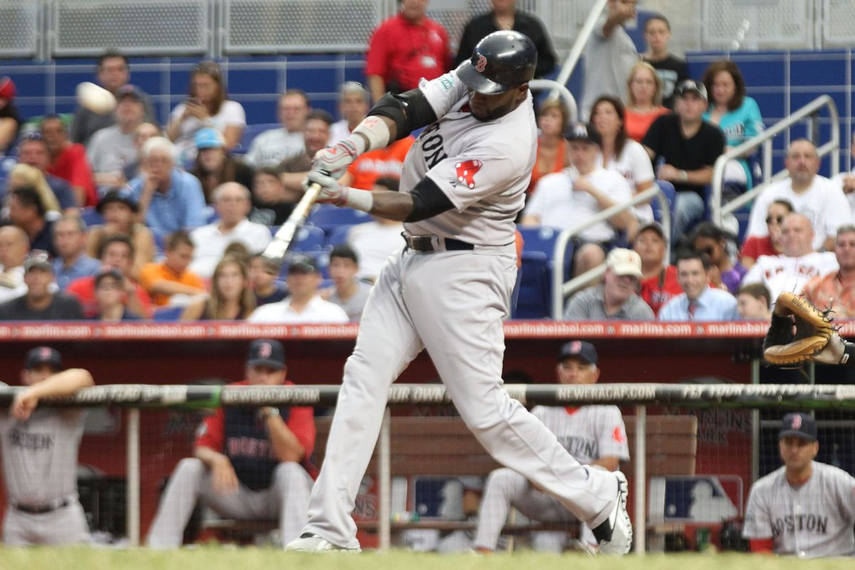 MIAMI, FL - JUNE 13:  David Ortiz #34 of the Boston Red Sox hits a solo home run against the Miami Marlins at Marlins Park on June 13, 2012 in Miami, Florida.  (Photo by Marc Serota/Getty Images)