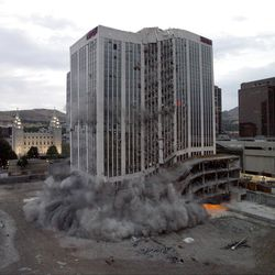 The old Key bank building is demolished in downtown Salt Lake City by explosives. August 17, 2007. City Creek.