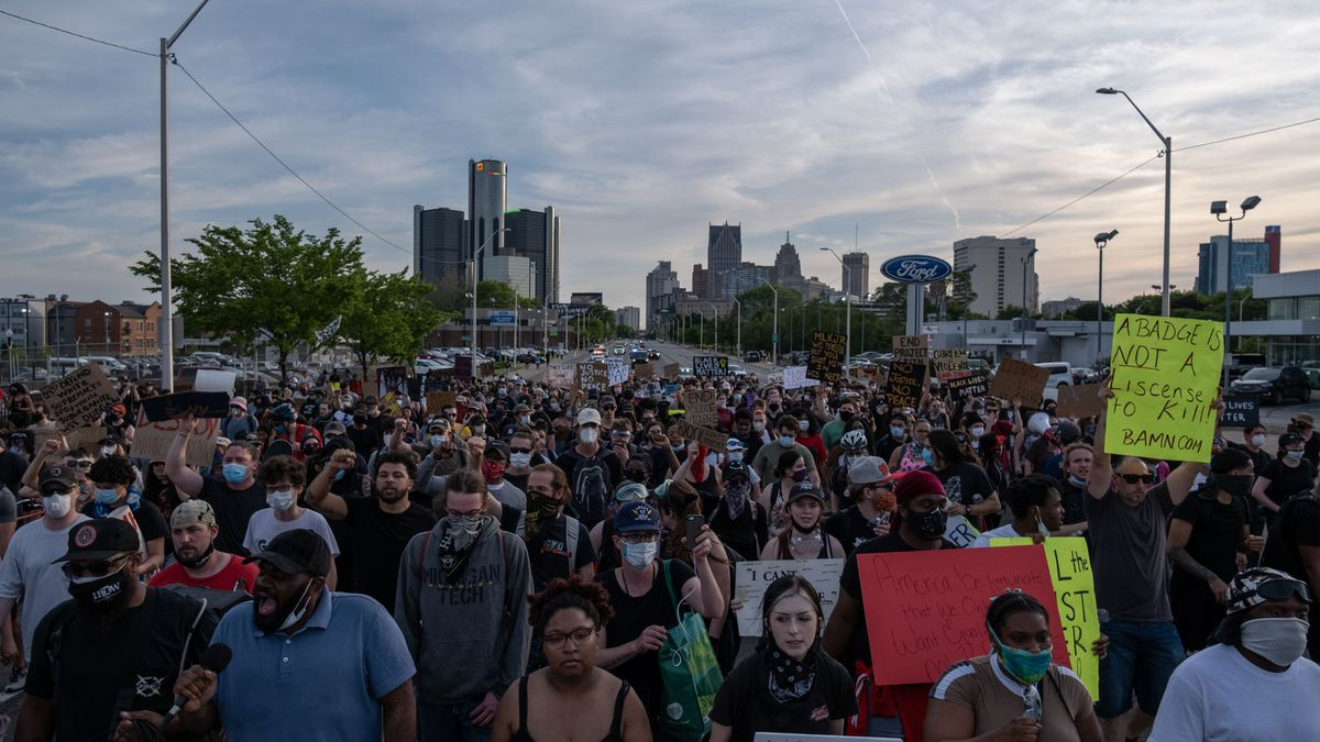 Protesters march during a peaceful demonstration over the death of George Floyd, in Detroit, Michigan, June 3,2020 - The Chief of Detroit Police James Craig later ended the curfew after protesters called for an end to the curfew.