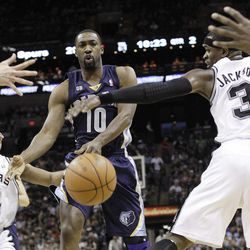 Memphis Grizzlies' Gilbert Arenas (10) is defended by San Antonio Spurs' Gary Neal, left, and Stephen Jackson (3) during the second quarter of an NBA basketball game on Thursday, April 12, 2012, in San Antonio.