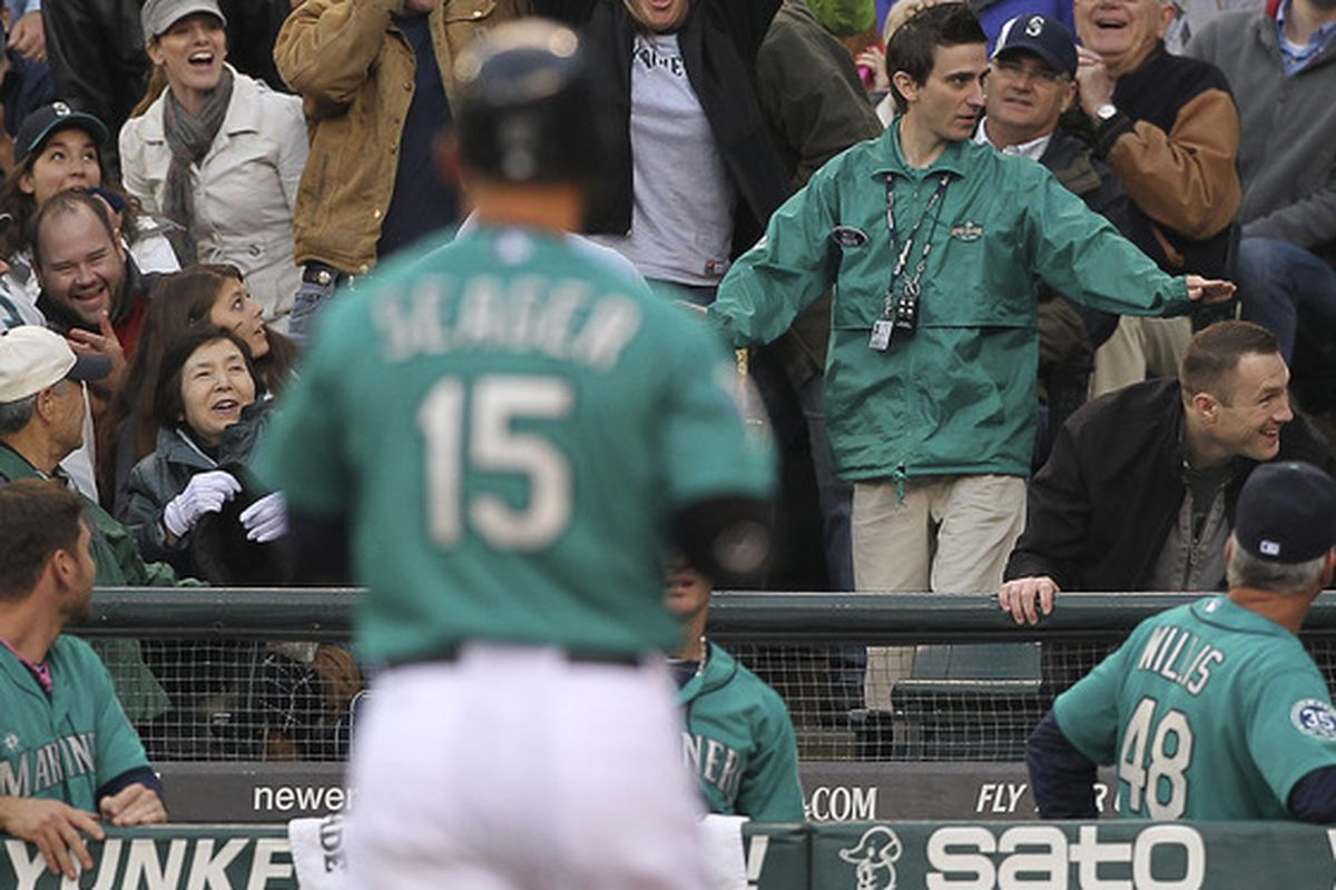 an unidentified woman steals Kyle Seager's baseball bat