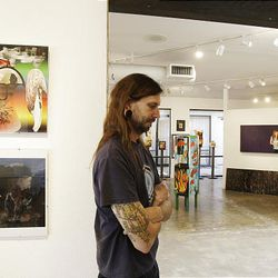 Kraig Foote, president of Art One Gallery, ponders his business future as he and other art gallery owners have a tough sell, and as a result, gallery owners in art communities are having to close shop or drastically change the way they do business.
